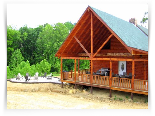 cabin side view with around porch and firepit on side